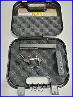 OEM Glock 23.40 cal Gen 3 complete slide, Lower parts kit, Magazine with case